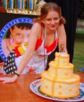 "My Grilled Cheese Wedding Cake: three tiers of over 150 grilled-cheese sandwiches, ""iced"" with cheese spread and E-Z Cheez."