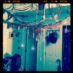 Mixed media installation: umbrella, silver chain, chandelier crystals